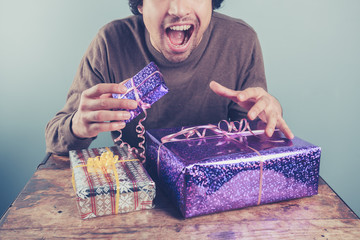 Young man excited about his presents