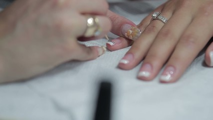 beautiful French manicure with rhinestones
