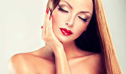 Girl with long straight hair and red lipstick and nails