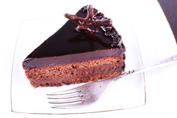 Delicious chocolate cake on plate close-up