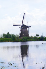 Windmill is reflected in water, Kinderdijk,  Netherlands
