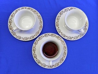 Porcelain or china coffee cup and two before filling