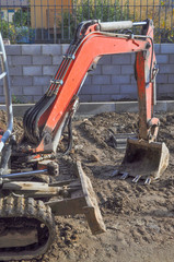 Excavator digging a hole