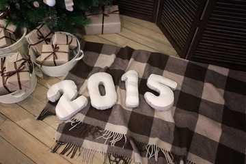 Happy New year 2015 and gifts under the tree