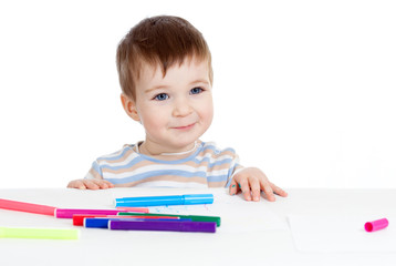 child drawing at table isolated