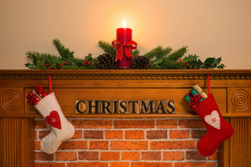 Christmas fireplace with stockings and candle