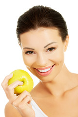 Smiling beauty holding green apple