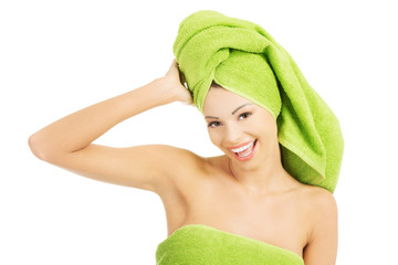 Portrait of beauty woman wrapped in towel