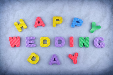 Happy wedding day sign made out of alphabet