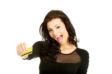 Happy cheerful woman holding credit card