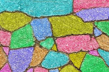 vintage background from colorful fragments of asphalt