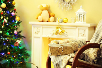 Beautiful Christmas interior with decorative fireplace and