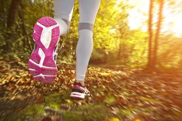 Girl running at sunset