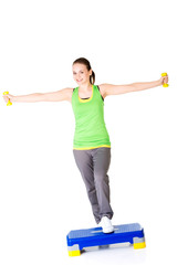 Beautiful sporty woman doing aerobic excersises