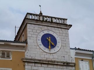 A roman clock above a historic gate in Cres in Croatia