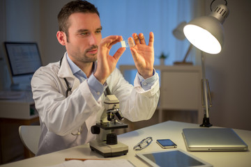 Young attractive scientist working late at office