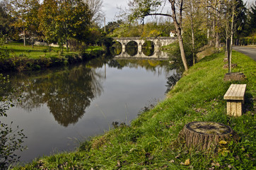 Le Luy de Béarn river and the old city bridge of  Sault-de-Nava