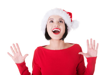 Portrait of surprised woman in santa clothes