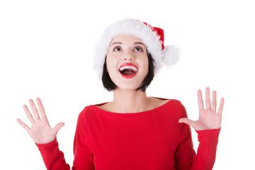 Portrait of surprised woman in santa clothes