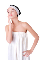 Portrait woman wrapped in towel touching chin