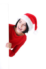 Woman in santa clothes with white empty banner