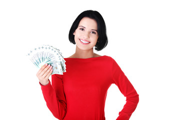Happy woman holding polish bills
