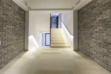 Stone wall corridor with staircase