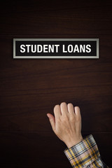 Hand is knocking on Student Loans door