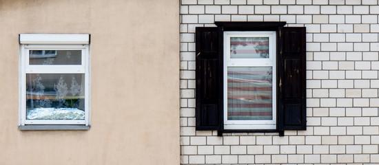 Wooden window with shutter doors.