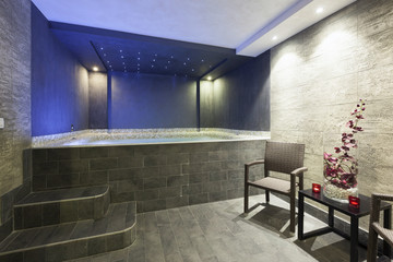 Interior of a hotel spa with jacuzzi bath with ambient light