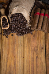 Cuban cigars and whole coffee beans on table