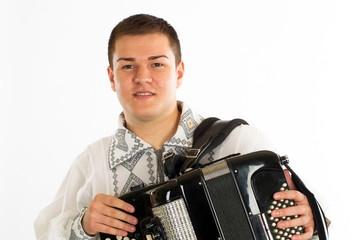 folklore dressed man with accordion on white background