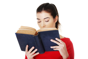 Portrait of student woman reading a book