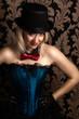 beautiful cabaret woman posing on a chair