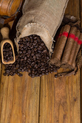 Typical cuban cigars and coffee beans on table