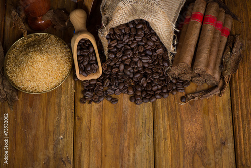 Fotobehang Caraïben Overhead view on table with cuban cigars and other products