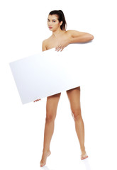 Full length nude woman holding blank banner