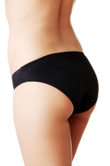 Close up on slim woman buttocks in underwear