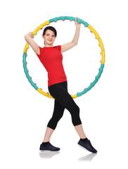 woman standing with hula hoop