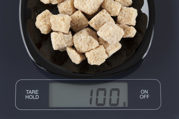 Brown cane sugars on kitchen scale