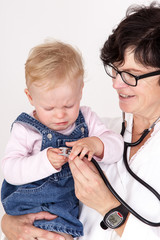 Doctor with stethoscope fun with toddler