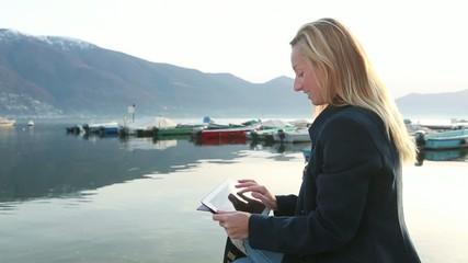 Woman using digital tablet of mountain peek