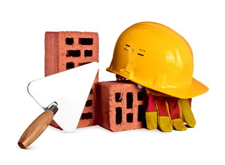 bricks, trowel and helmet on white isolated background