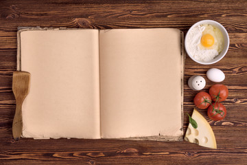old cook book, the ingredients for a meal on a background of vin