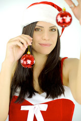 Woman Santa holding Christmas balls