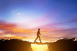 Man walking over precipice between mountains. Human bridge