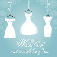 Three bridal dress.Winter wedding.Snowflake background