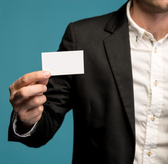 Businessman holding business card in hand