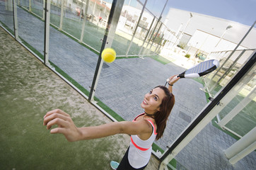 Paddle tennis shot: woman is ready