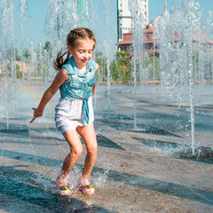 little girl having fun in fountain